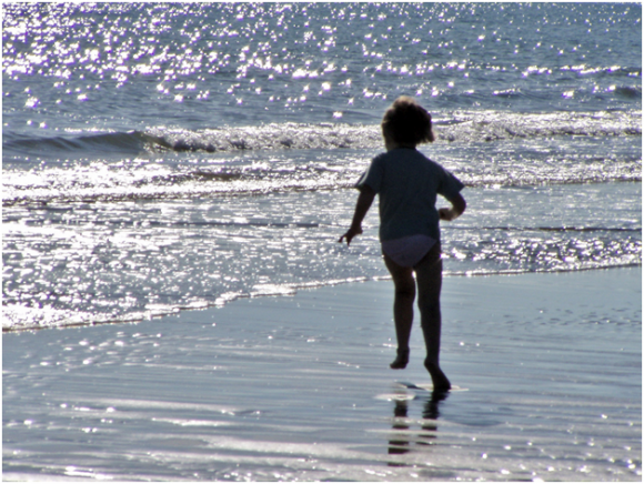 Child playing, Bibione beach ( creative commons)